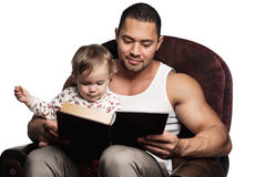 Father reading book to daughter Royalty Free Stock Images