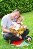 Father reading a book to his daughter Stock Photo