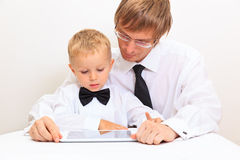 Father reading book to kids Stock Image