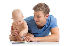 Father reading a book to son baby. Isolated Royalty Free Stock Photos