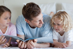 Father reading with his children Royalty Free Stock Image