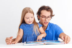 Father reading with his daughter stock photo