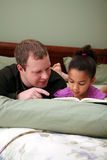 Father Reading To Daughter Stock Photo