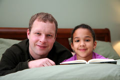Father Reading To Daughter Royalty Free Stock Photos