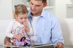 Father reading to her daughter. Royalty Free Stock Image