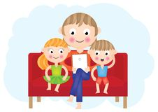 Father reading to his daughter and son Stock Photo