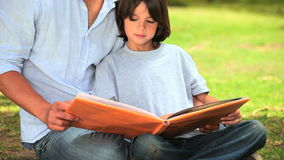 Father reading to his son Stock Photos