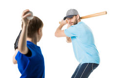 Father ready to hit the ball by baseball bat. Isolated on white Stock Photo