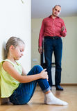 Father rebuking  daughter for offence. Caucasian father rebuking small daughter for offence at home Stock Photography