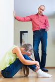 Father rebuking  daughter for offence. European father rebuking small daughter for offence at home Stock Photos