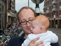 Father with a redheaded baby in his arms Stock Photo