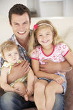 Father Relaxing with Daughters At Home Royalty Free Stock Photos