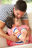 Father Relaxing At Home With Daughter Stock Photos