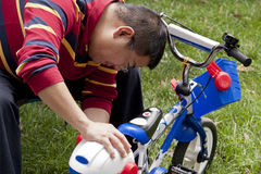 Father repairing bicycle Royalty Free Stock Image