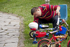 Father repairing bicycle Stock Images