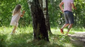 Father is running with his Daughter in summer park, slow-motion stock video footage