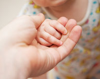Father's and baby's hands Stock Images