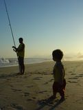 Father's day. Father and his son in the beach Royalty Free Stock Photos