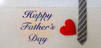 Father`s day card concept. Necktie and red heart on canvas background, banner style Royalty Free Stock Photography