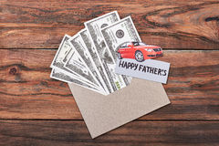 Father`s Day card and dollars. Paper car on envelope. Great present for super dad Royalty Free Stock Images