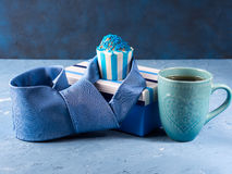 Father`s day card with gift box and cup cake, tie. Mug of coffee on blue background Stock Image