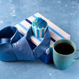Father`s day card with gift box and cup cake, tie Stock Photography