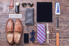 Father`s Day card near accessories. Cologne, tablet and sunglasses. Modern men`s fashion trends Royalty Free Stock Photo