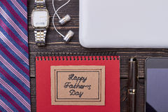 Father`s Day card near accessories. Gadgets on wooden background. Modern dad`s look Royalty Free Stock Photography