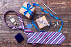 Father`s Day card near presents. Striped tie near watch. When father is a businessman Royalty Free Stock Photography