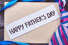 Father`s Day card near tie. Ribbon and greeting card. Present for dear daddy Stock Image