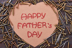 Father`s Day card and screws. Royalty Free Stock Images