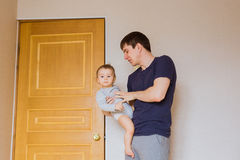 Father`s day concept - Happy family father and baby child son indoors.  stock photo