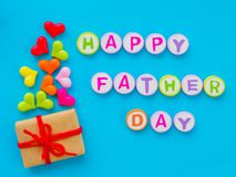 Father`s day concept. HAPPY FATHER DAY alphabet. With colorful heart and gift on blue background royalty free stock photo
