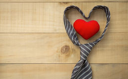 Father`s day concept. Heart in necktie over wood background, Father`s day concept royalty free stock images