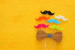 Father& x27;s day concept. Hipster colorful and funny moustache. On yellow wooden background royalty free stock photo