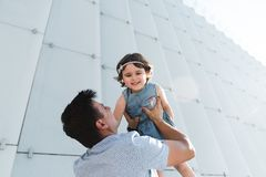 Father`s day. Happy family daughter hugs his dad on holiday stock photography
