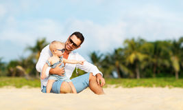 Father`s day. Dad and baby son playing together outdoors on a su. Mmer beach stock photography
