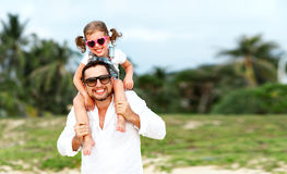 Father`s day. Dad and child daughter playing together outdoors o Royalty Free Stock Image
