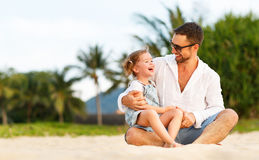 Father`s day. Dad and child daughter playing together outdoors o Stock Photos