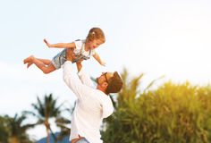 Father`s day. Dad and child daughter playing together outdoors o Royalty Free Stock Images