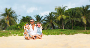 Father`s day. Dad and children playing together outdoors on a su. Mmer beach Stock Images