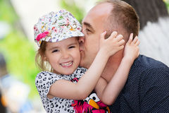 Father's day. Dad kissing his daughter. Stock Images