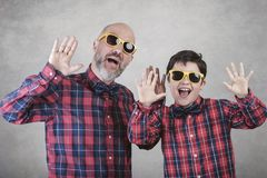 Father`s day,father and son with tie and sunglasses royalty free stock images