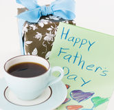 Father's day gift. Cup of coffee with father's day gift and card Royalty Free Stock Photo