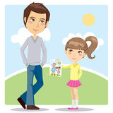 Father's Day Gift. Young daughter giving a hand drawn illustration gift to her daddy on Father's Day celebration Stock Photo