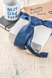 Father`s Day gift concept. Greeting card background, gift box, tie decoration, mug with inscription Best Dad Ever, notebook, copy space Royalty Free Stock Image