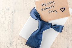 Father`s Day gift concept. Greeting card background, gift box, tie decoration,  top view copy space Stock Photography