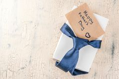 Father`s Day gift concept. Greeting card background, gift box, tie decoration,  copy space top view Stock Photo