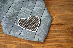 Father's Day gift: Grey tie and paper heart Royalty Free Stock Image
