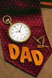 Father's Day Gift. Photo of a tie, watch and cuff-links with the word Dad as a father's day gift Royalty Free Stock Photo